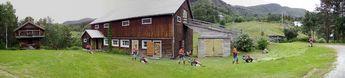 My wife, Nina, working like six farmers in Hallingdal, Norway, July 2002 © 2002 Knut Dalen